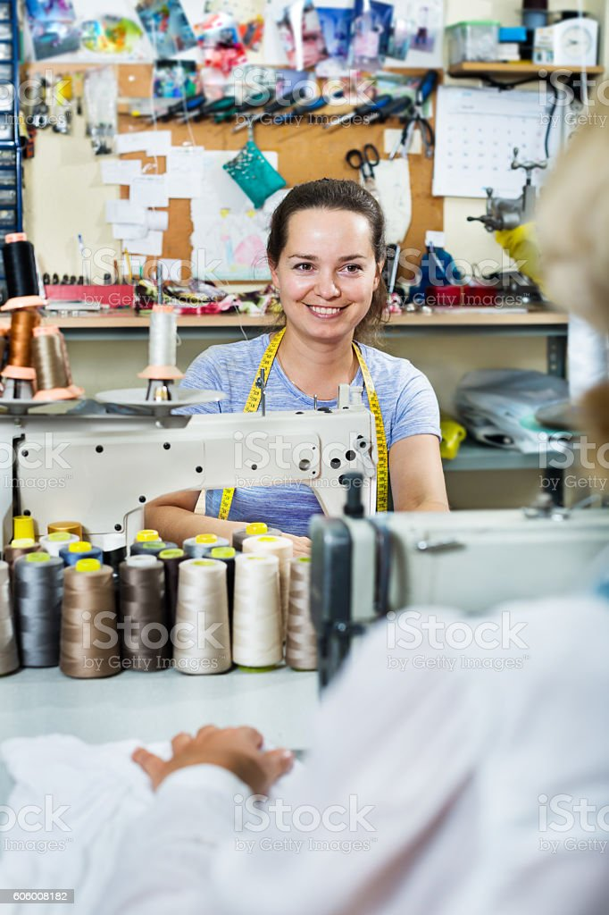 Female tailors working in sewing workshop stock photo