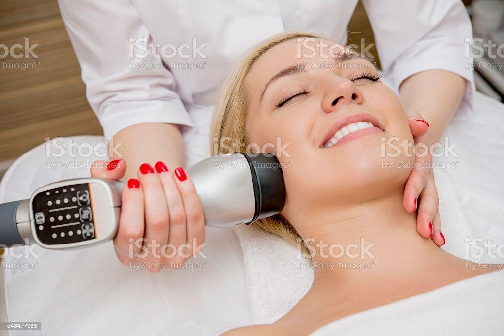 Female taking a facial massage stock photo