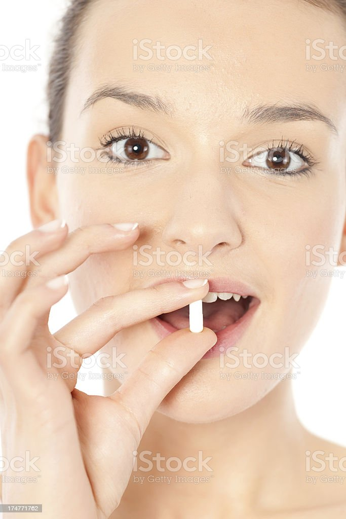 Female taking a pill royalty-free stock photo