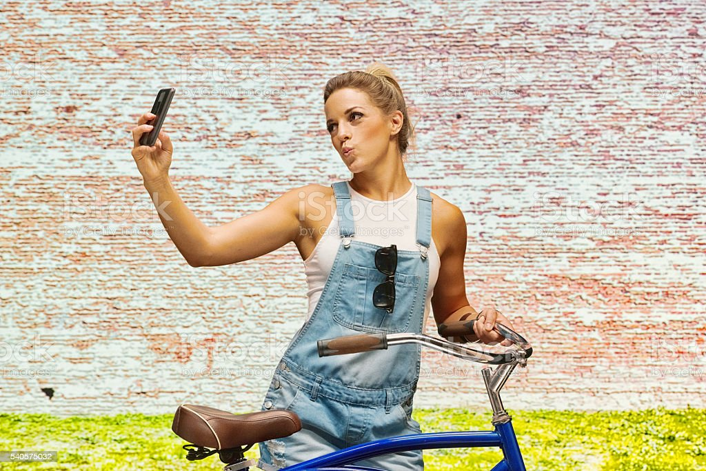 Female taking a selfie outdoors stock photo