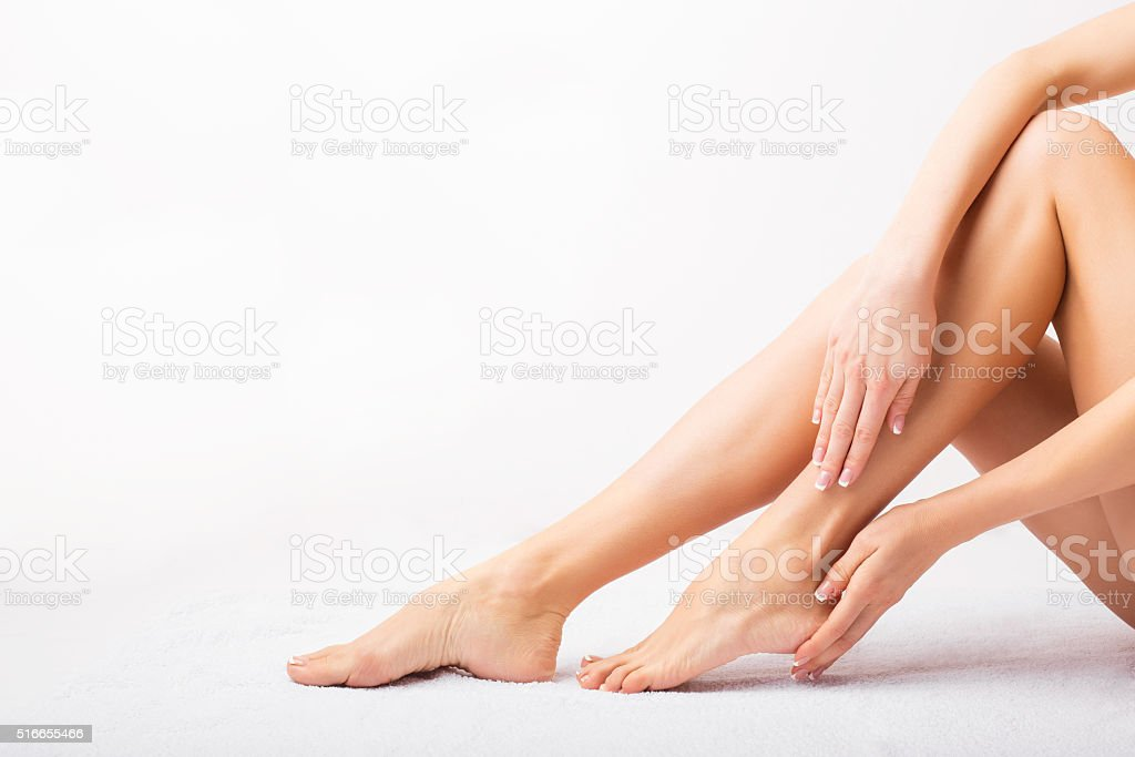 Female taking care of her feet stock photo