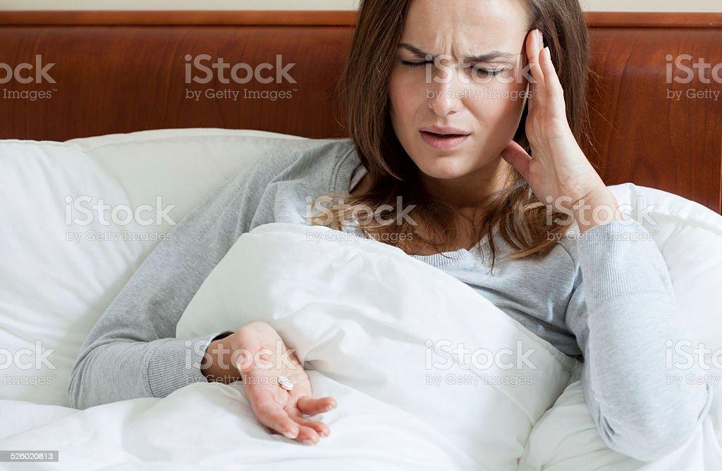 Female taking painkillers stock photo