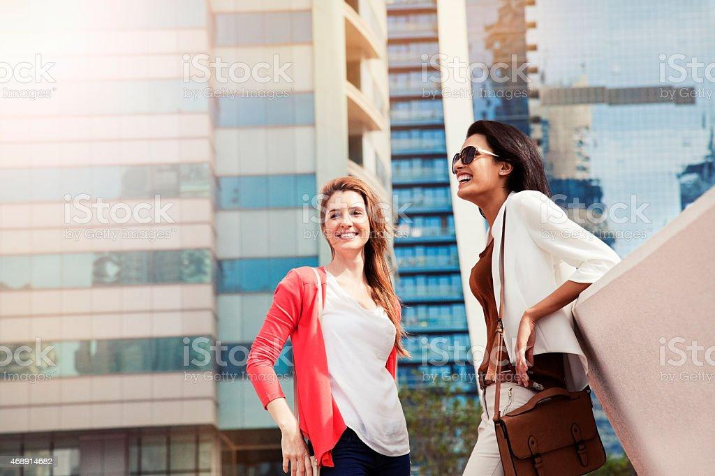 Female Talking Each Other in Dubai. stock photo