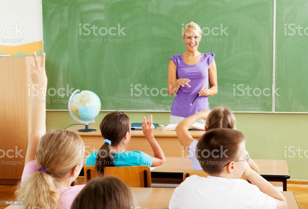 Female Teacher Questioning little students royalty-free stock photo