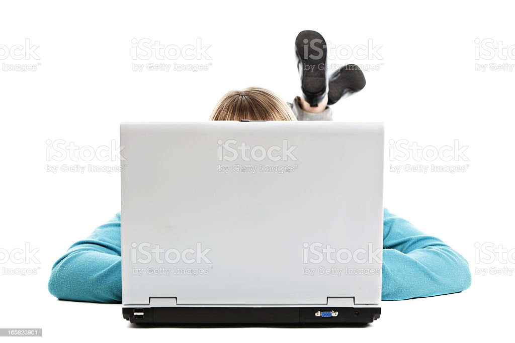 Female teen behind a laptop royalty-free stock photo