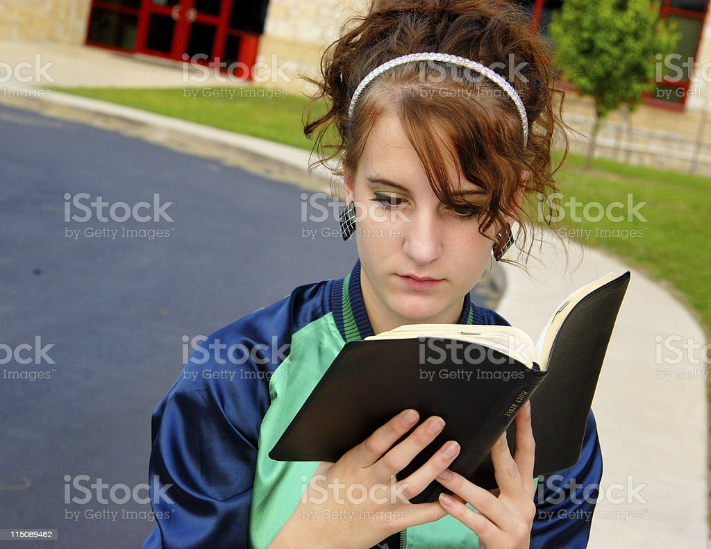 female teen student studying bible royalty-free stock photo
