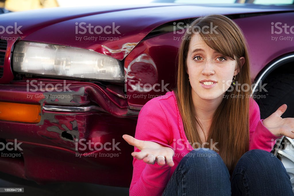 Female Teenage Driver in Denial over Auto Accident stock photo
