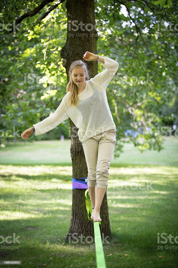 female teenager Balancing on a Slackline stock photo