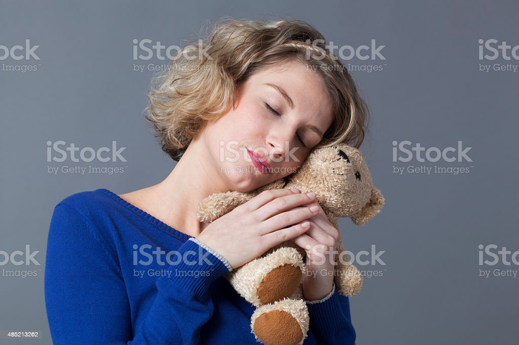 female tenderness for happiness and cozyness stock photo