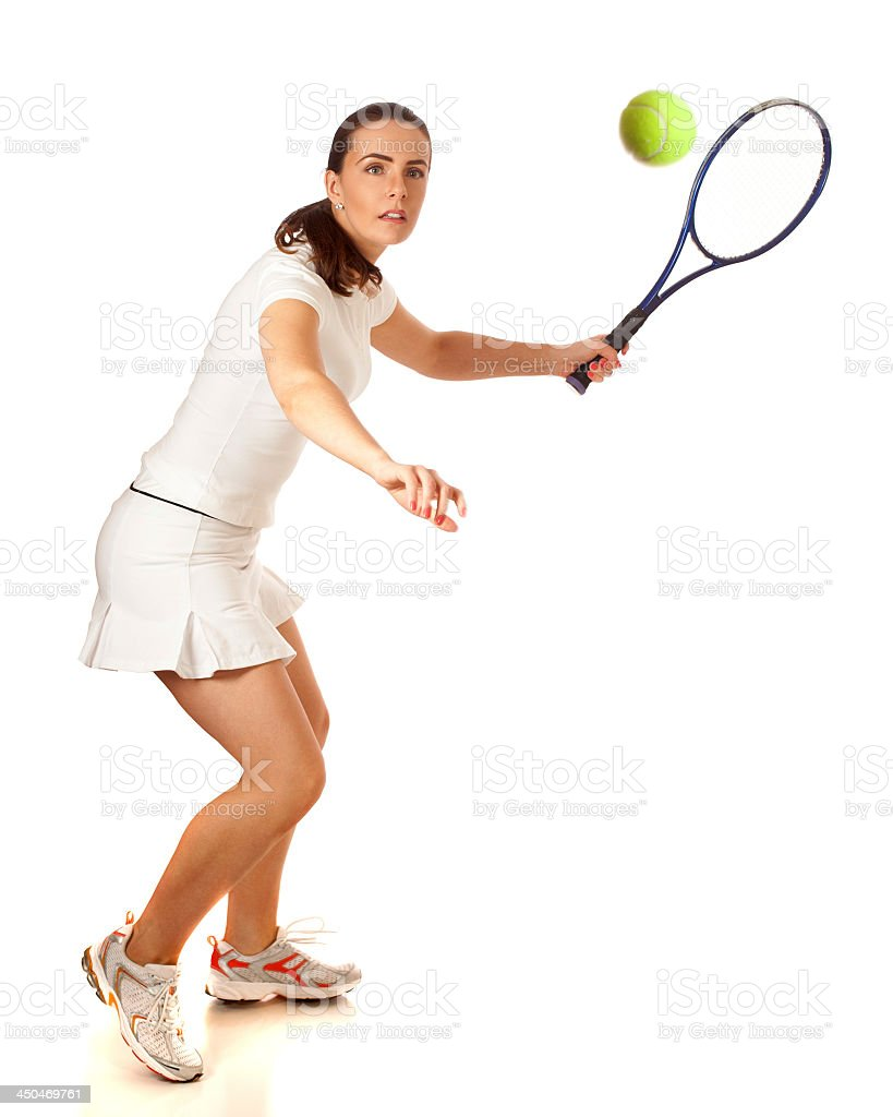 Female tennis player about to hit the ball stock photo