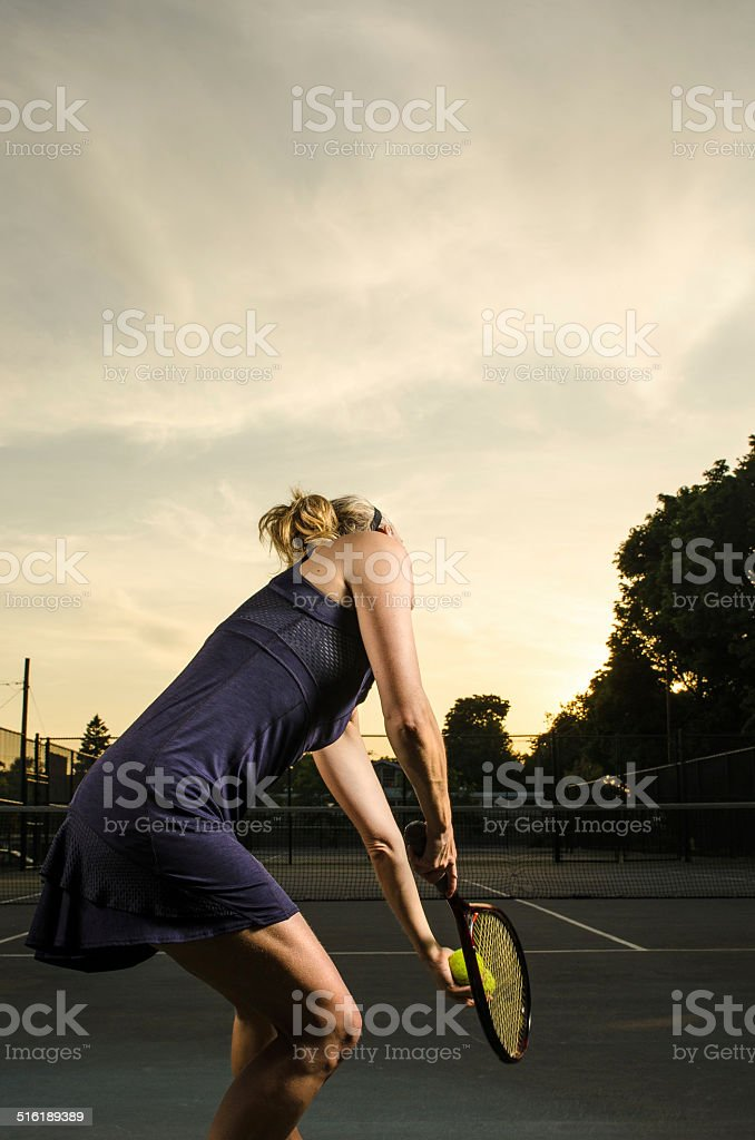 Female tennis player about to serve stock photo