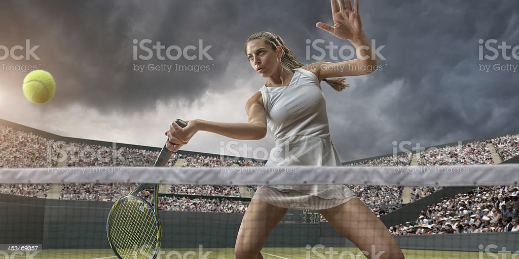 Female Tennis Player About To Strike Ball royalty-free stock photo