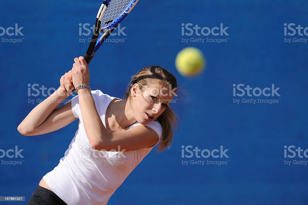 Female tennis player at backhend drive royalty-free stock photo