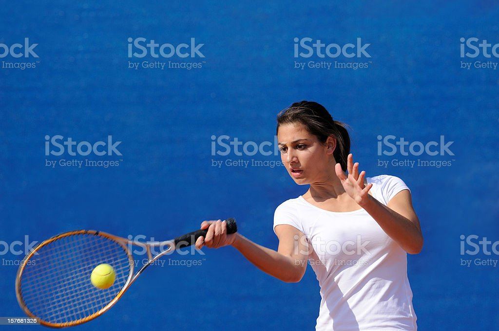 Female tennis player at forehand royalty-free stock photo