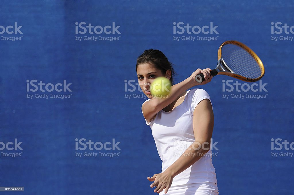 Female tennis player at forehand stock photo
