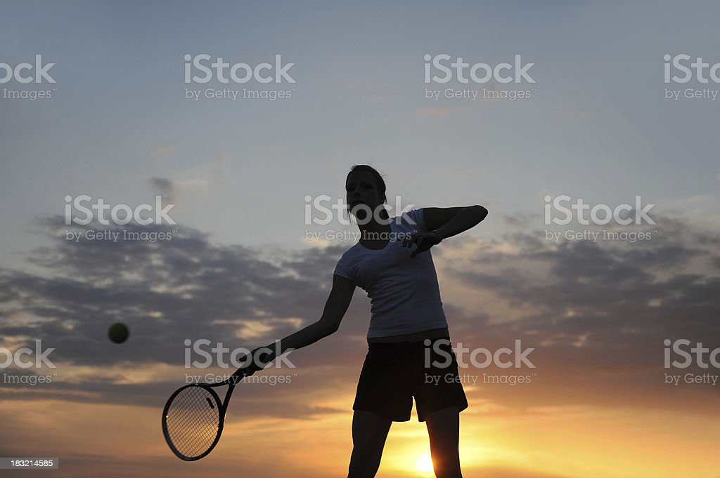 Female tennis player at sunset royalty-free stock photo