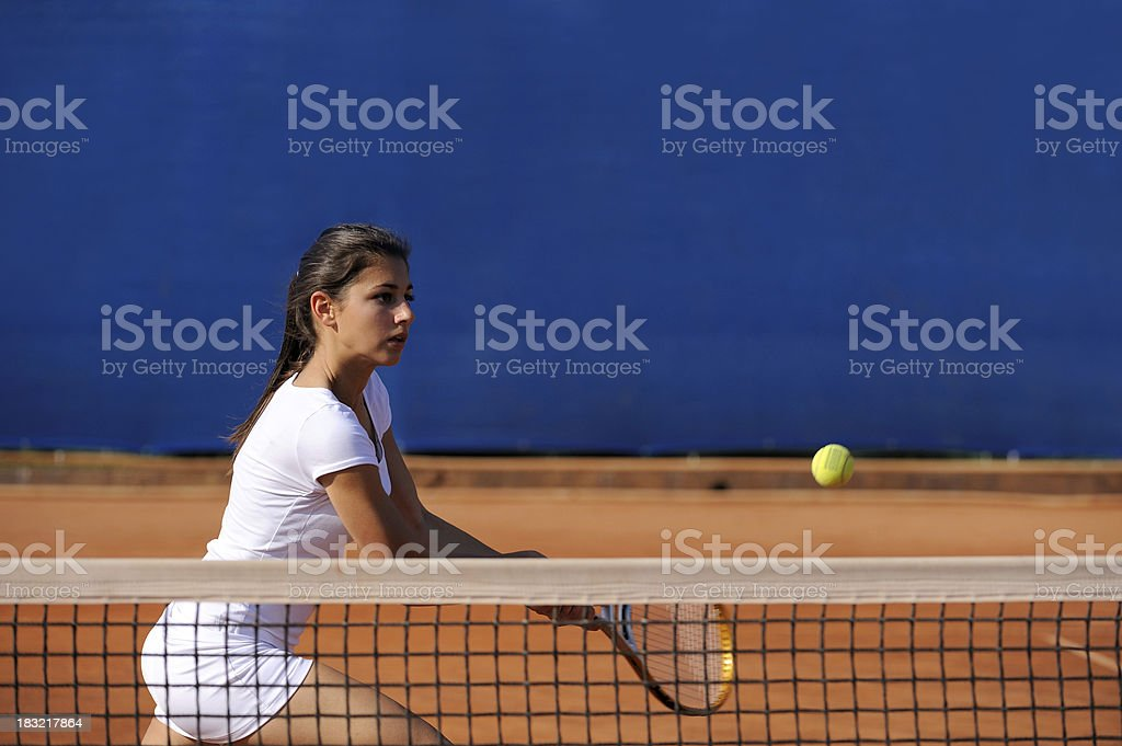Female tennis player at volley royalty-free stock photo