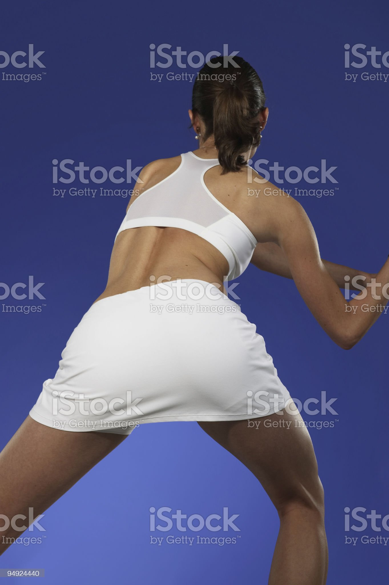 Female tennis player from the back royalty-free stock photo