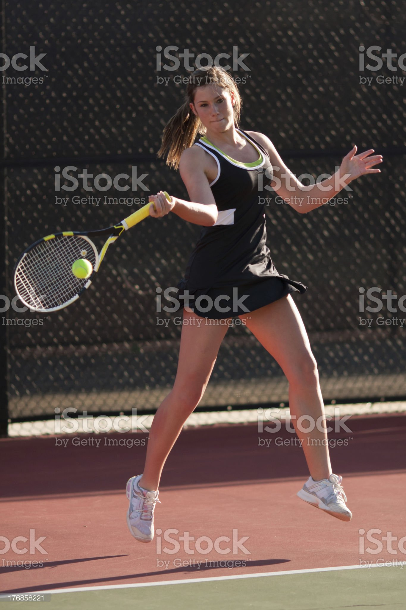 Female Tennis Player Hits Forehand royalty-free stock photo