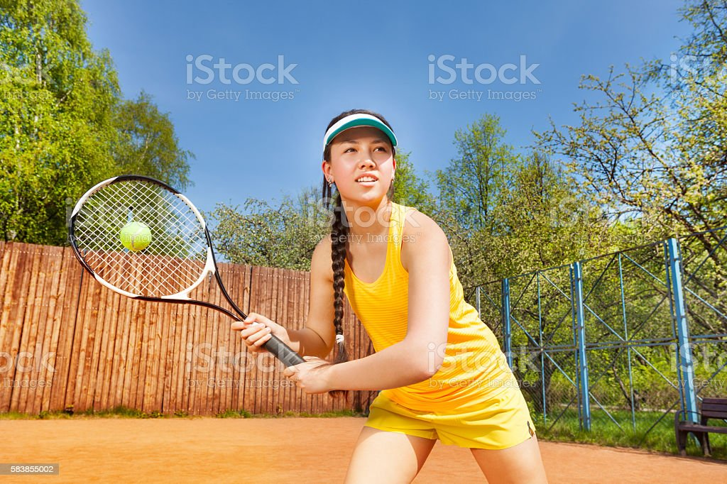 Female tennis player in action outdoor stock photo