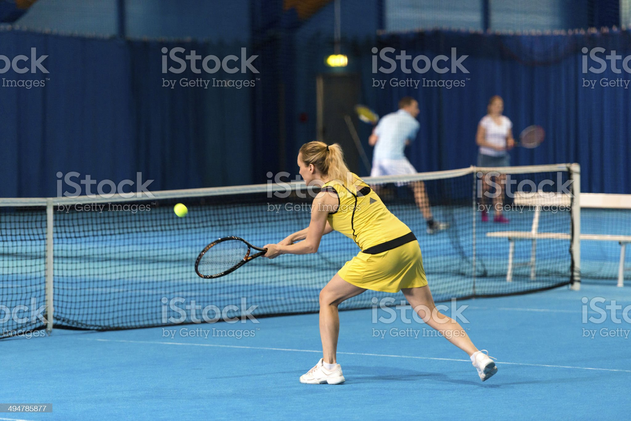 Female Tennis Player In Action royalty-free stock photo