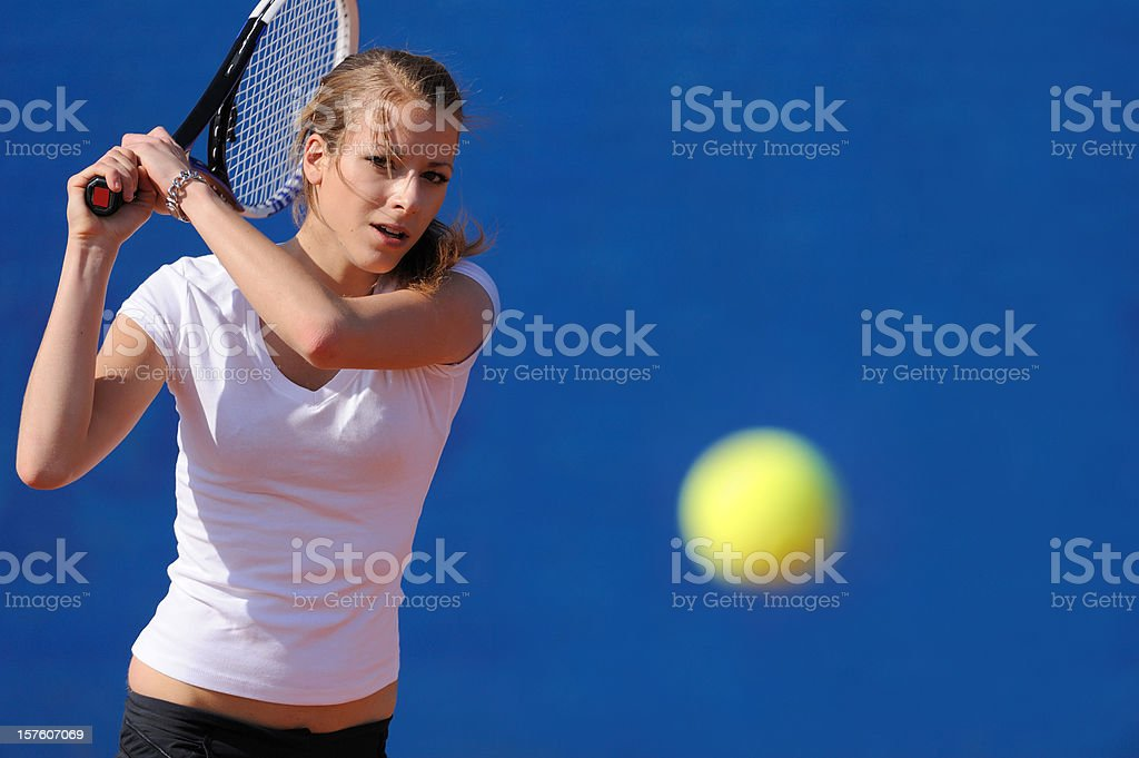 Female tennis player in the action royalty-free stock photo
