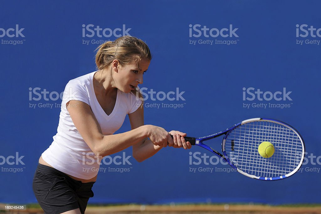 Female tennis player performing backhand royalty-free stock photo