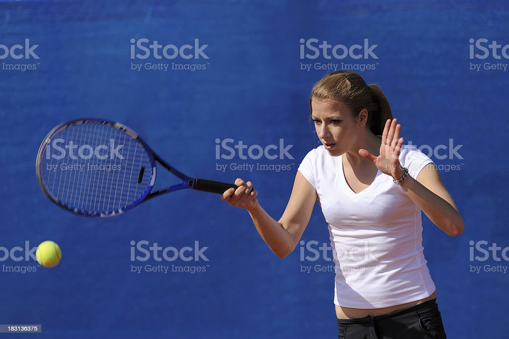 Female tennis player performing forehand royalty-free stock photo