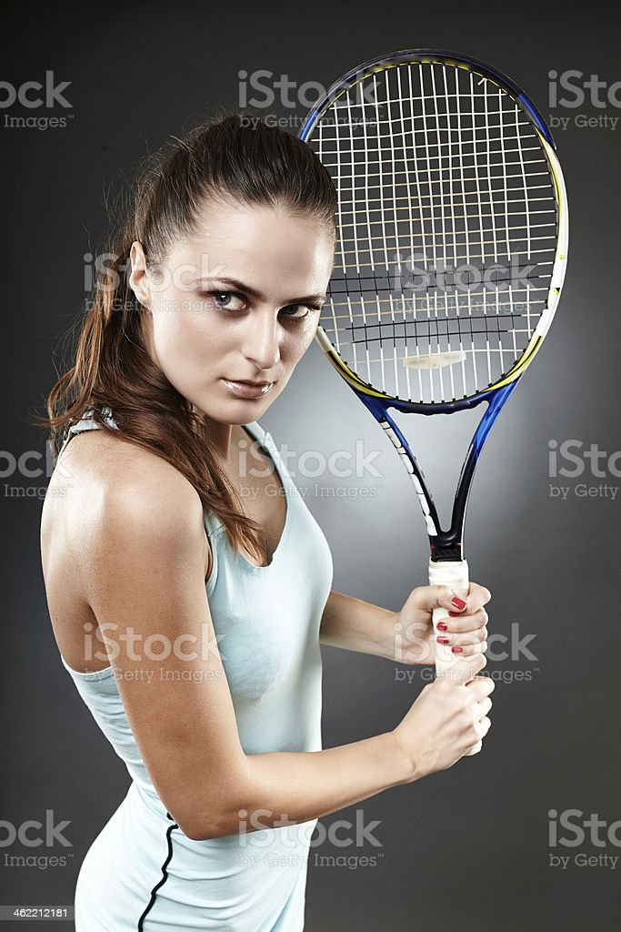 Female tennis player preparing to execute a backhand volley stock photo