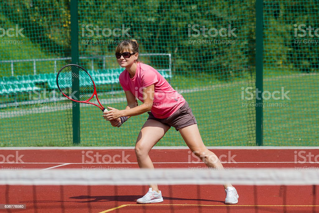 Female tennis player preparing to hit a forehand stock photo