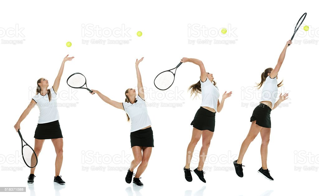 Female tennis player serving stock photo