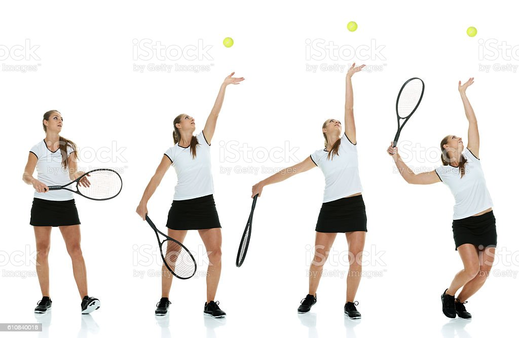 Female tennis player serving the ball stock photo