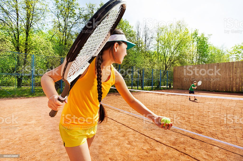 Female tennis player starting set on clay court stock photo