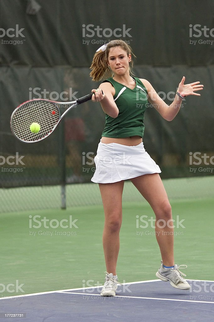 Female Tennis Player Strokes Forehand Shot royalty-free stock photo