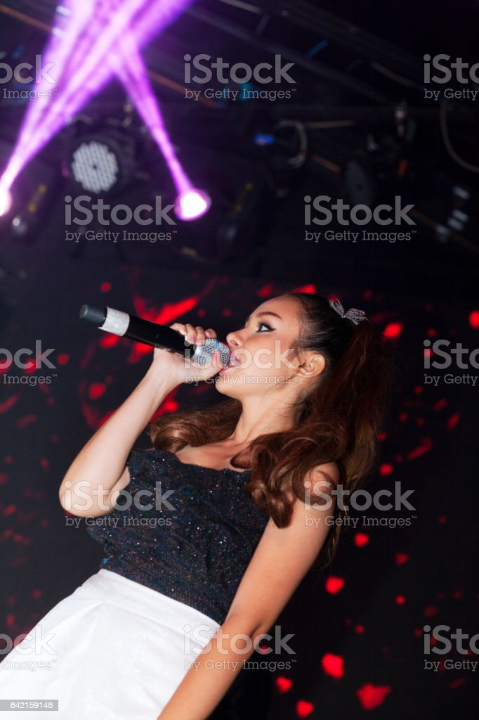 Female thai pop singer in club stock photo