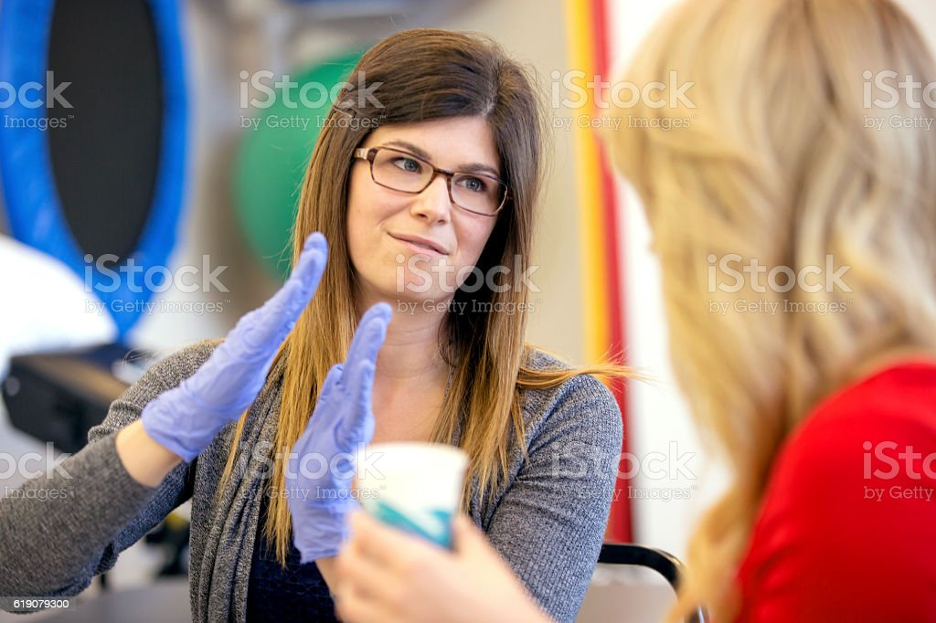Female therapist explaining a concept to a patient stock photo