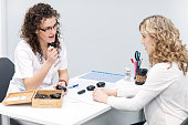 Female Therapist Showing Set Of Massage Stones