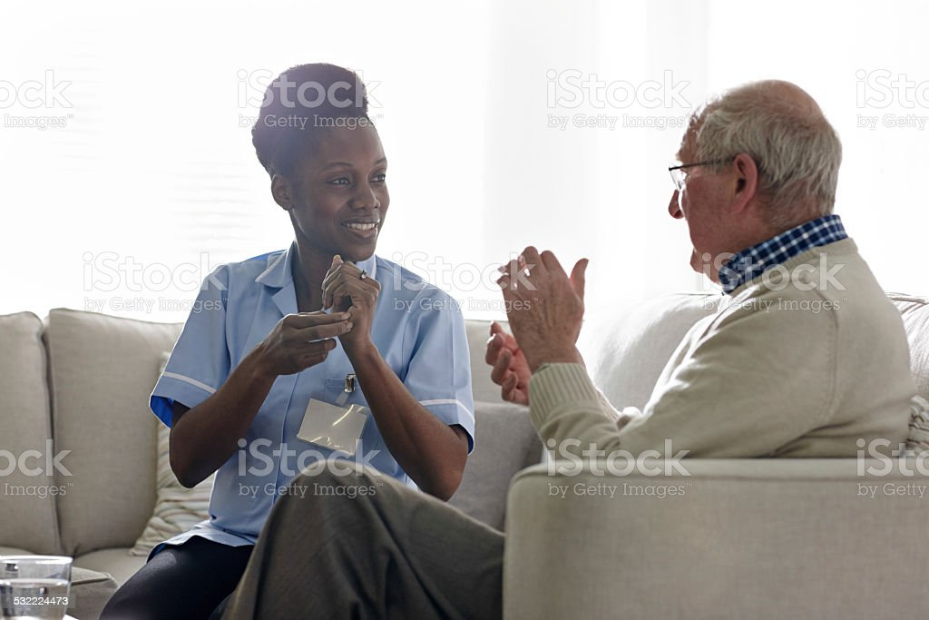Female theropist carrying out tapping session with a senior man stock photo