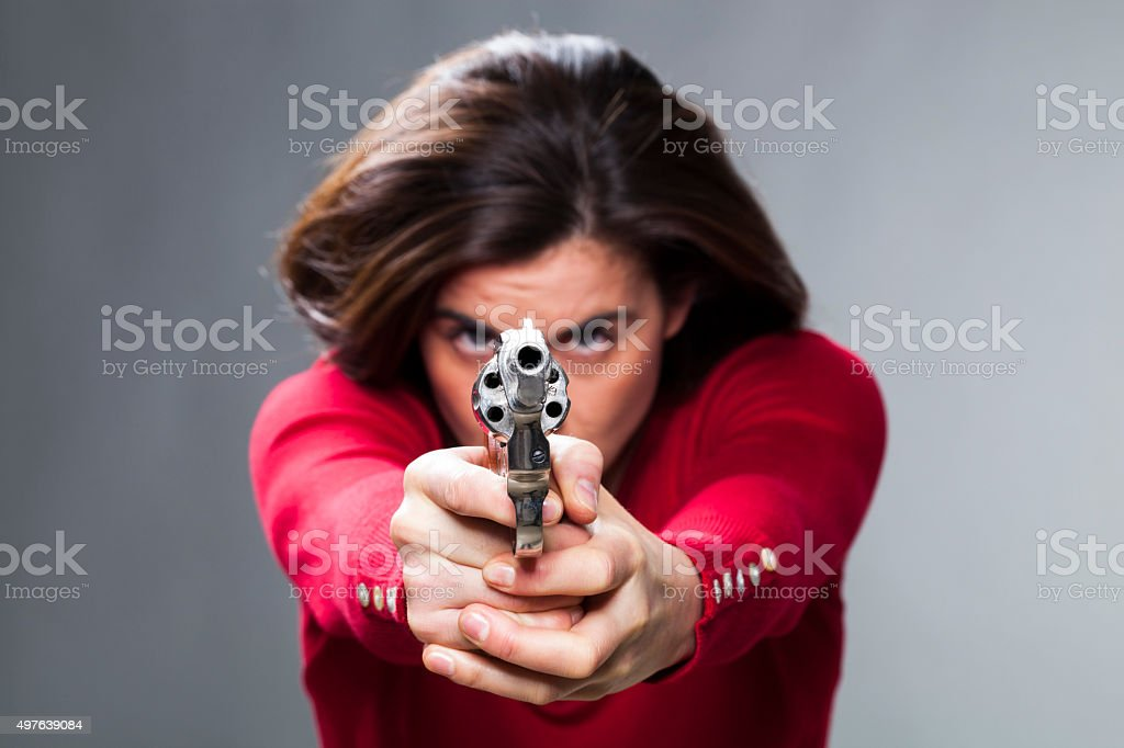 female tight hands to revolver to shoot straight to target stock photo