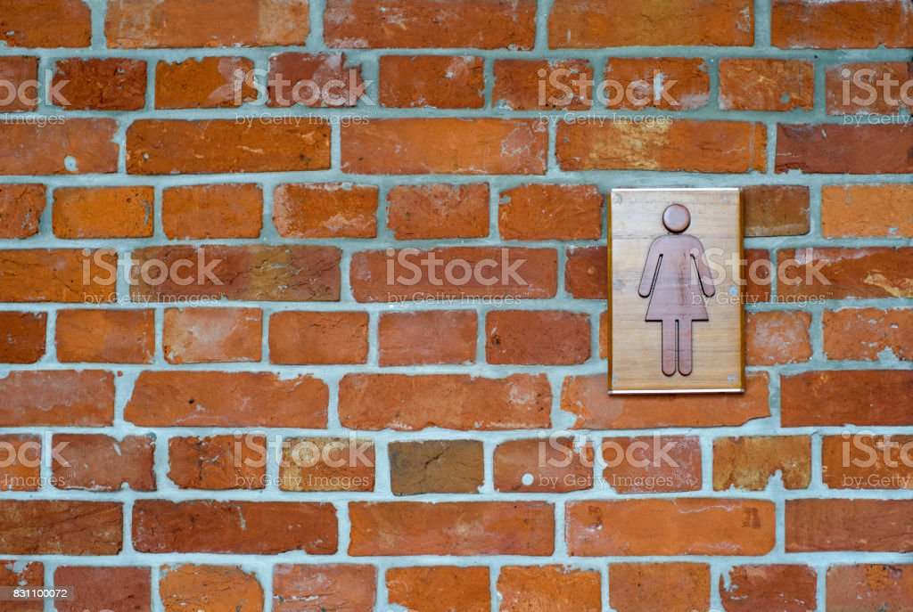 female toilet sign on the brick wall. stock photo