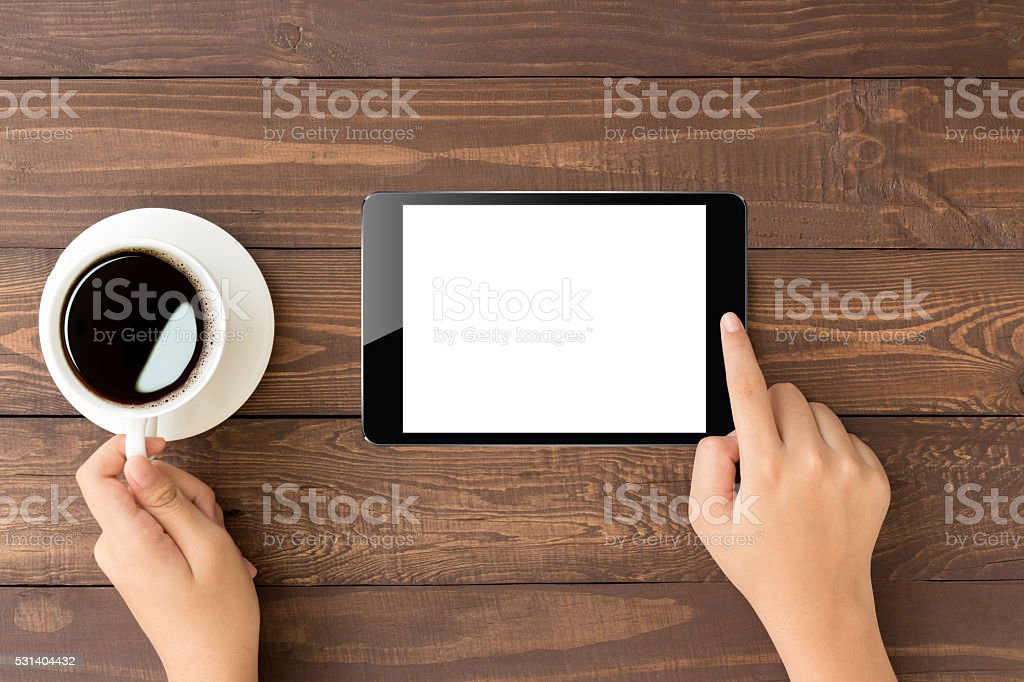 female touch on digital tablet blank screen on top view stock photo