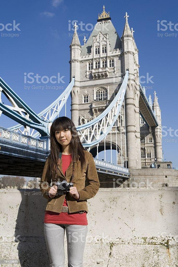 Female tourist by tower bridge royalty-free stock photo