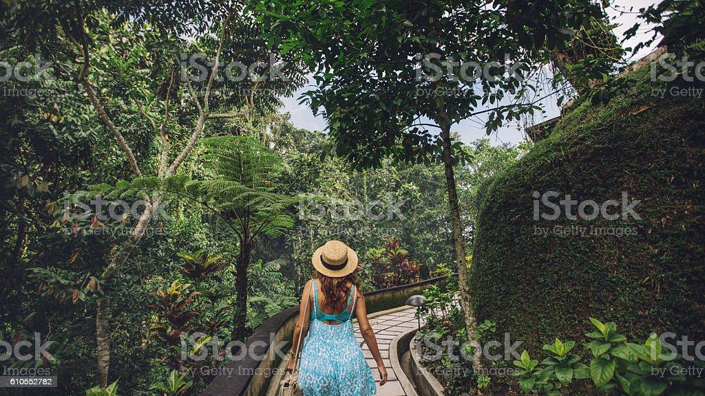 Female tourist in tropical garden stock photo
