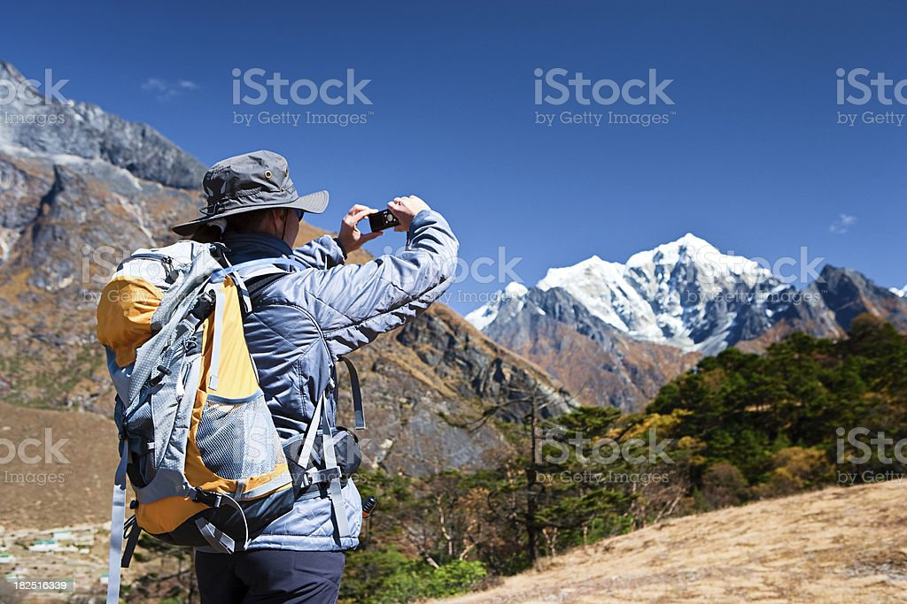 Female tourist is taking picture  in Mount Everest National Park royalty-free stock photo