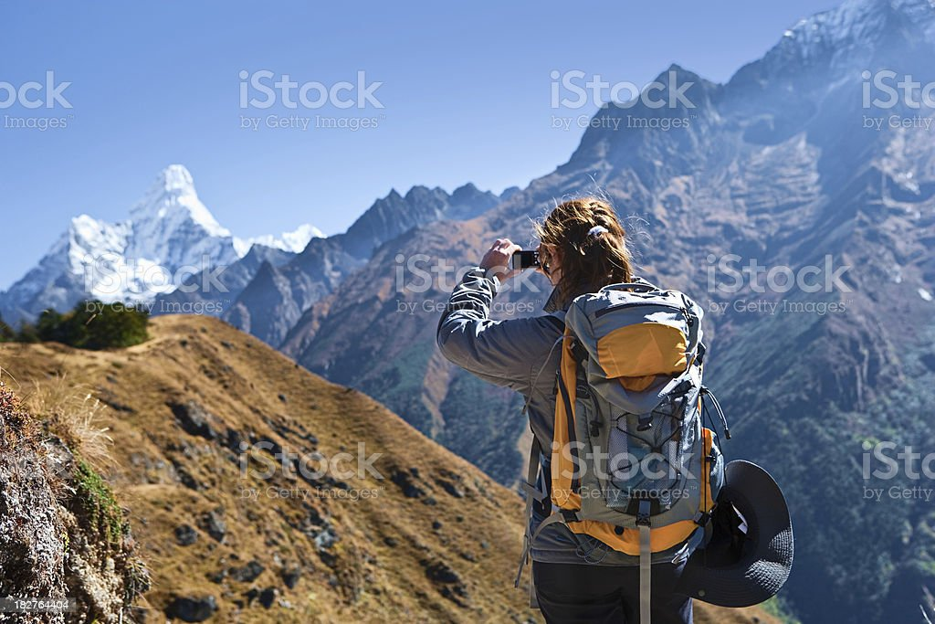 Female tourist is taking picture of Mount Ama Dablam royalty-free stock photo