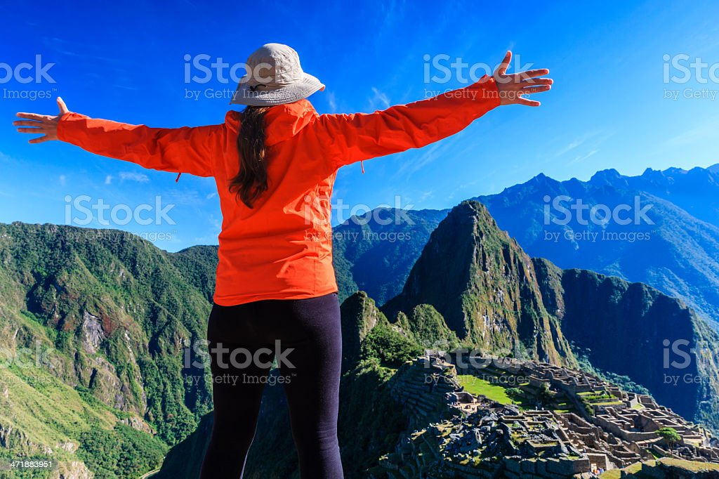 Female tourist looking at Machu Picchu stock photo