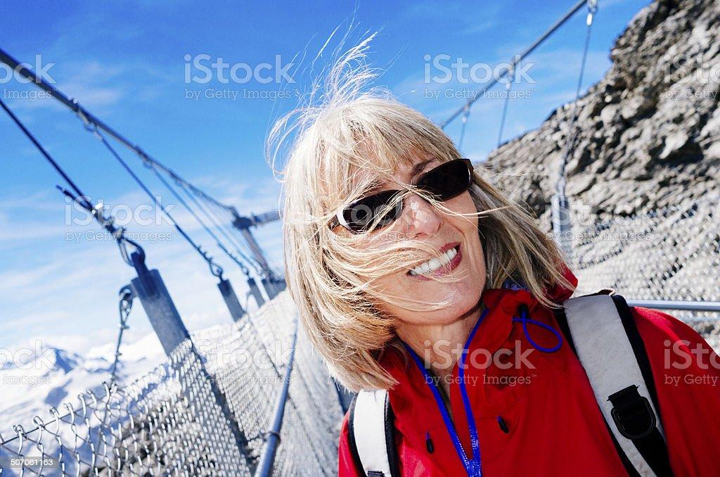 Female tourist on Mt.Titlis walkway Switzerland stock photo