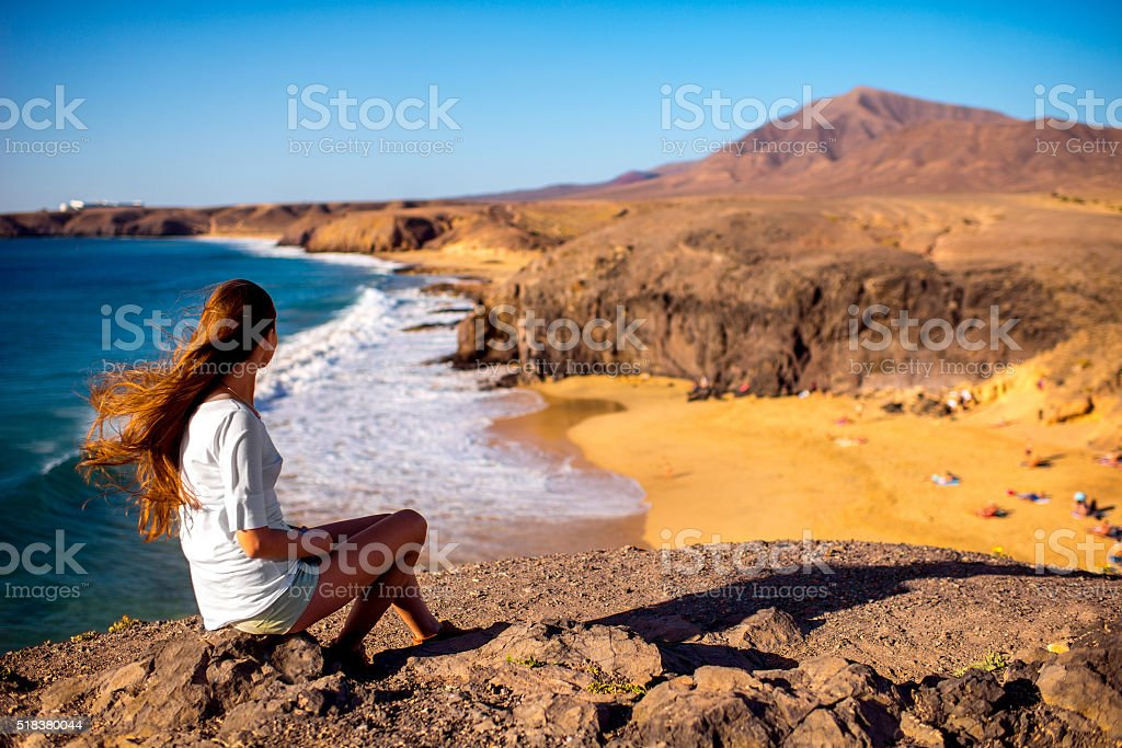 Female tourist on Papagayo beach stock photo