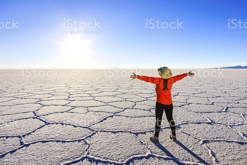 Female tourist on Salar de Uyuni, Altiplano, Bolivia stock photo