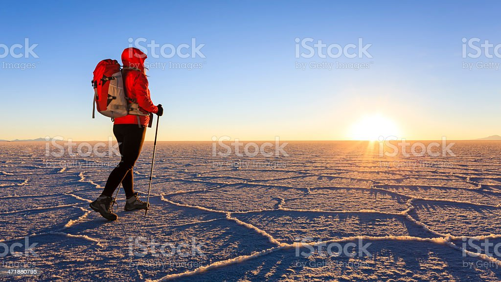 Female tourist on Salar de Uyuni during sunset, Altiplano Bolivia stock photo